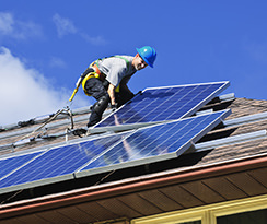 Electrican Installing Solar Panels - Energy Conservation and Renewables Dropdown