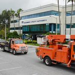 Trucks in front of utility headquarters building