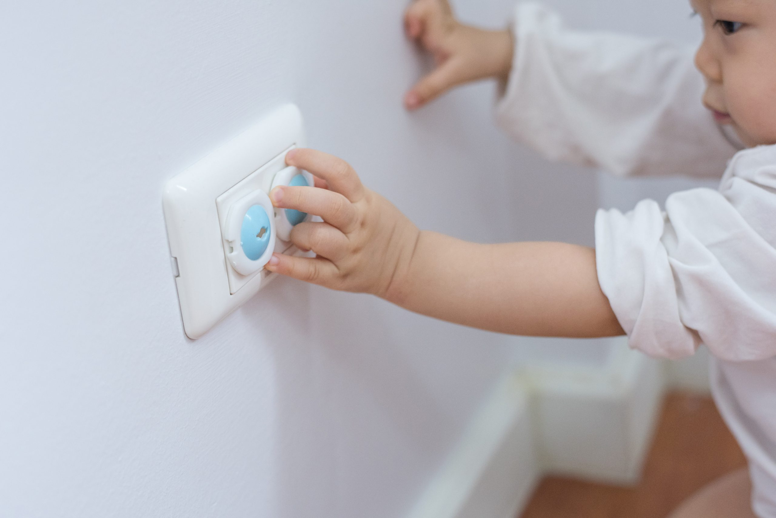 baby touching outlet
